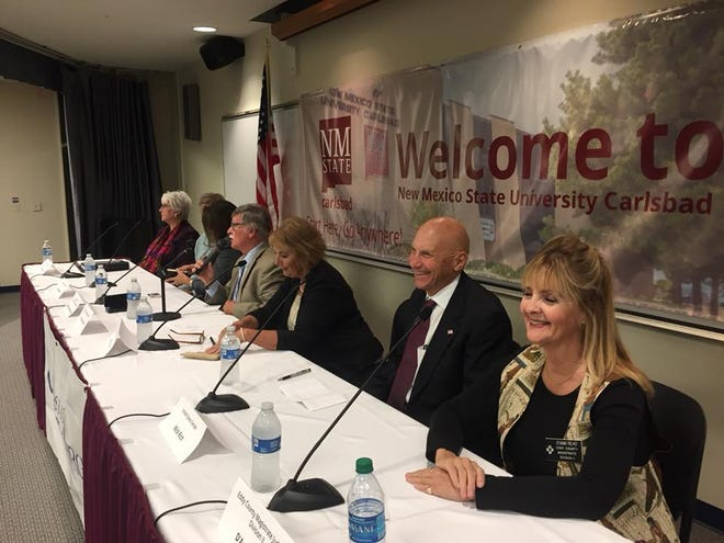 Political candidates share a light moment before Wednesday's forum at NMSU-Carlsbad.