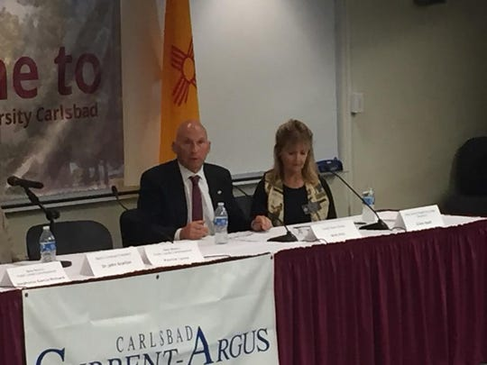 Republican U.S. Senate candidate Mick Rich speaks while Eddy County Division II Magistrate D'Ann Read listens during Wednesday's candidate forum at NMSU-Carlsbad.