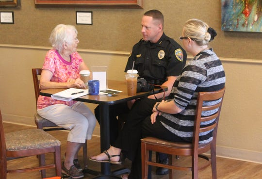 "Alamogordo resident Lucille Cosgrove, left, spoke with APD Deputy Chief Michael Lawrence at the APD's Coffee with a Cop event. ""I feel very safe in this town. Every city has crime, but you're doing great,"" Cosgrove said."
