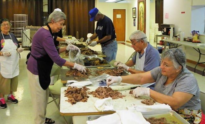 Volunteers at Immaculate Conception Catholic Church in Alamogordo prepare taco meat for Fiesta de la Familia.