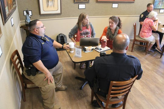 Approximately 30 residents made the rounds at Patron's Hall and spoke with officers from various units within the APD for the department's first Coffee with a Cop event.