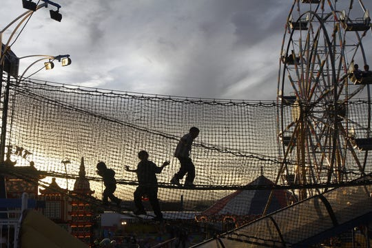 Children traverse a fun house bridge, Friday evening, Oct. 5, 2012,  at the Northern Navajo Nation Fairgrounds in Shiprock.