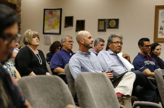 Audience members listen to Deputy Secretary of the Interior David Bernhardt Tuesday during a San Juan County Commission meeting in Aztec.