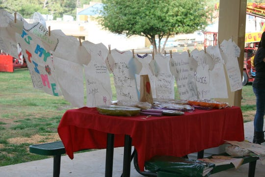HEAL T-shirt and posters were on display at the vigil.