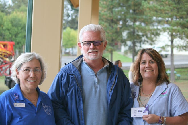 Lorra Fike, executive director of Hope Harbor, left, attended with Ruidoso Mayor Lynn Crawford and Micah Woodul, president of Help End Abuse for Life.