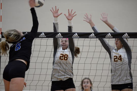 Marian's Christine Audette (8) and Mercy players Julia Bishop (28) and Mallory Conrad.