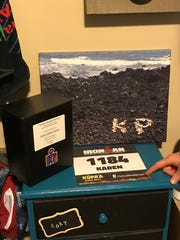 Nikki Derrick talks about several items in her Ironman training room, dedicated to the late Karen Perzyk.