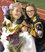 South Lyon homecoming queen Breanna Strange is pictured with longtime friend Kinsey Nally moments after the crowning of the king and queen.