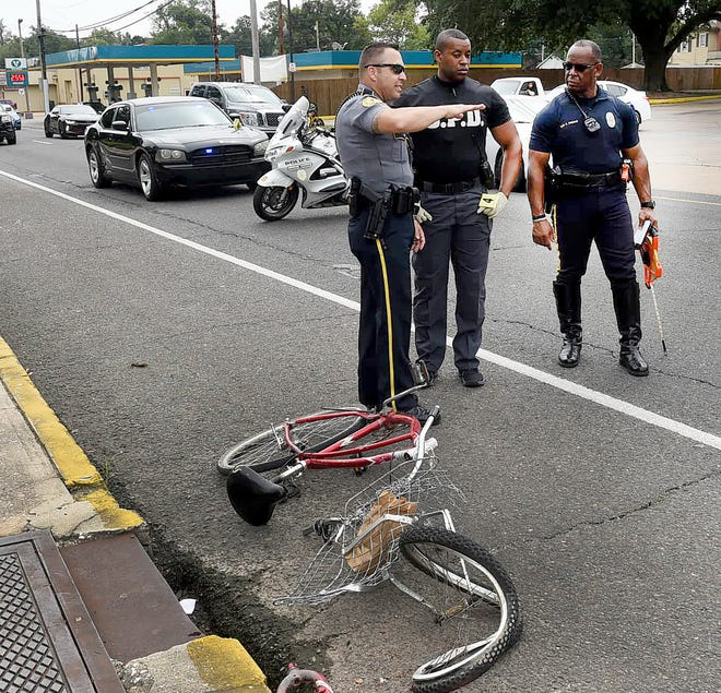 Officers with the Opelousas Police Department at the scene of an accident involving a bicycle and an 18 wheeler that occurred around 11 a.m. Saturday at the intersection on Landry and Lombard Streets in downtown Opelousas. The cyclist was taken to Opelousas General Health System with undetermined injuries.