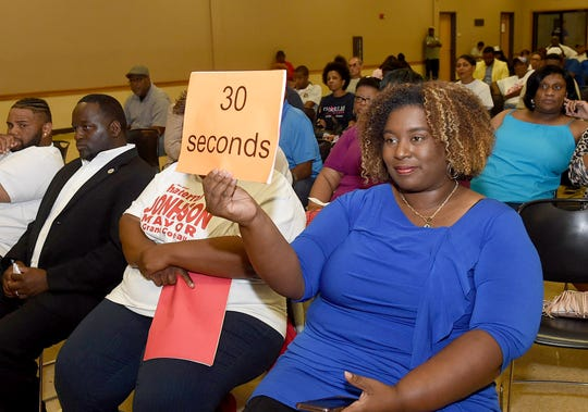 Keeping time at the recently held candidates forum hosted by St. Landry Democrats.