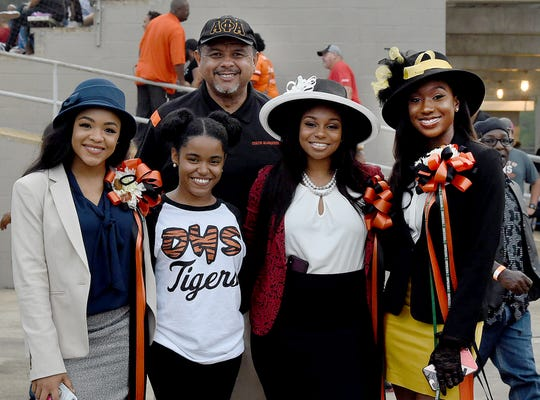 Opelousas Alderman Julius Alsandor poses for a picture with members of the Opelousas High School homecoming prior to the start of their homecoming game last Friday at Donald Gardner Stadium.
