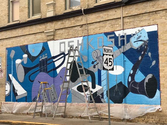 Local artist Leif Larson has been creating a new mural mural near the New Moon Café, 401 N. Main St., Oshkosh.