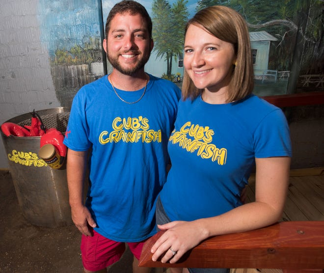 Clay and Delaney Cubley stand for a photo Wednesday as they prepared for the opening of Cub's Crawfish in Warrington on Oct. 11.