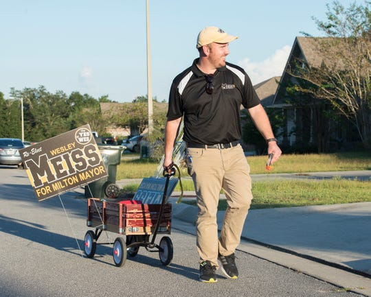 Milton Mayor Wesley Meiss pulls a wagon filled with campaign materials as he goes door to door during his re-election campaign in Milton on Tuesday, October 2, 2018.
