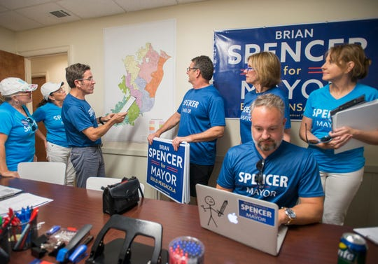 Pensacola Mayoral candidate Brian Spencer talks with his volunteers at his campaign headquarters in Pensacola on Wednesday, October 3, 2018.