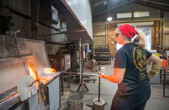 Glass artist fellow Hillary Heckard creates a glass pumpkin in preparation for the 12th annual Pumpkin Patch fundraiser at the First City Art Center in Pensacola on Wednesday, October 3, 2018.