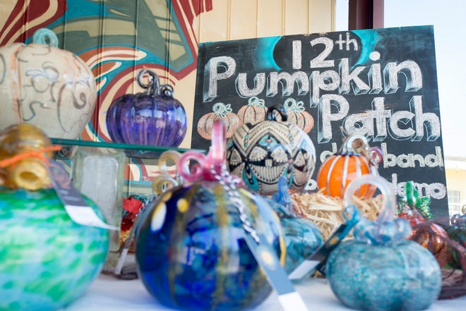 Glass pumpkins are being sorted as they prepare for the 12th annual Pumpkin Patch fundraiser at the First City Art Center in Pensacola on Wednesday, October 3, 2018.