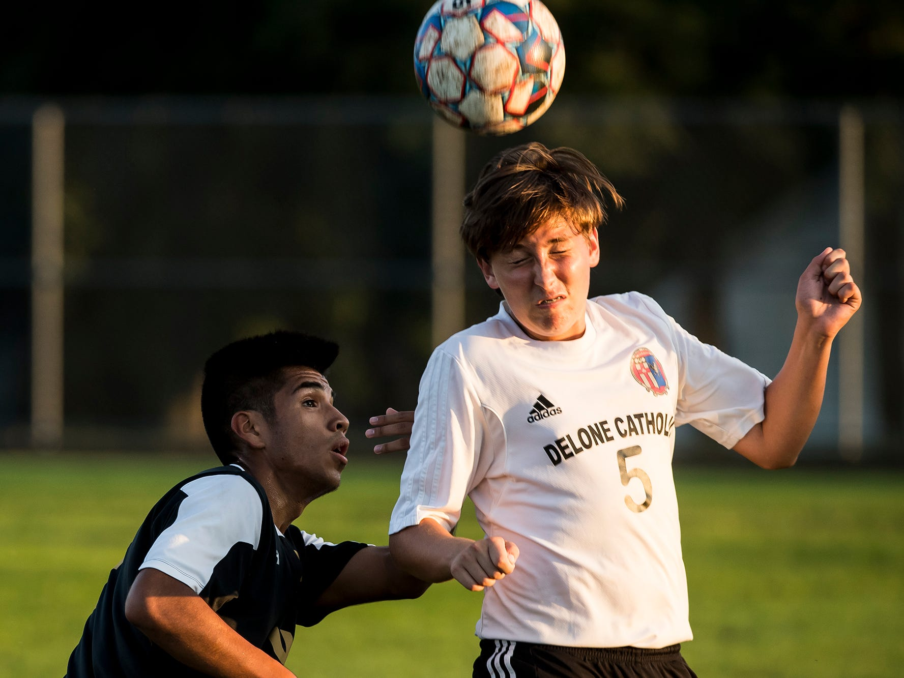 Delone Catholic's Andrew Gervasi hits a header during a game against Biglerville on Wednesday, October 3, 2018. The Squires fell 3-0.