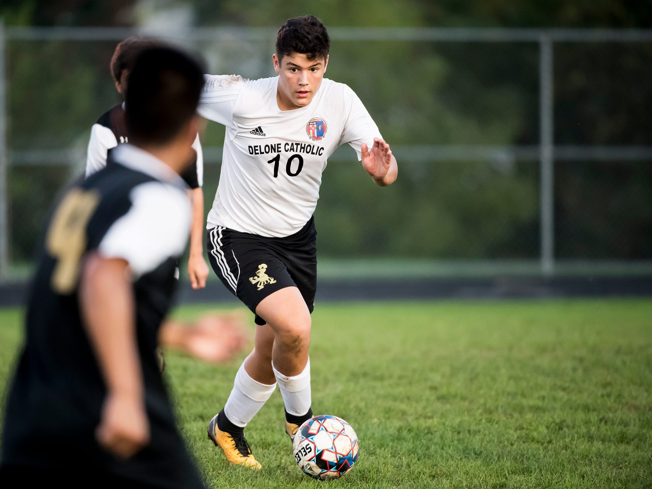 Delone Catholic's Thomas Dolce dribbles down the field during a game against Biglerville on Wednesday, October 3, 2018. The Squires fell 3-0.