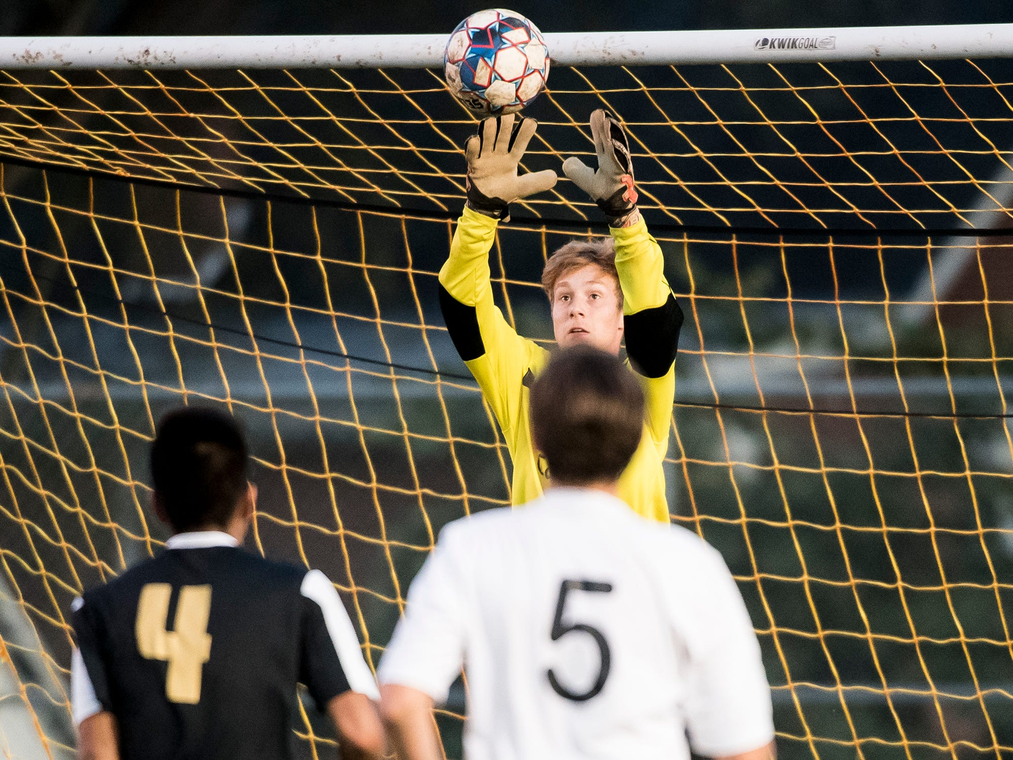 Delone Catholic goalkeeper Jacob Boccabella jumps up to grab the ball during a game against Biglerville on Wednesday, October 3, 2018. The Squires fell 3-0.