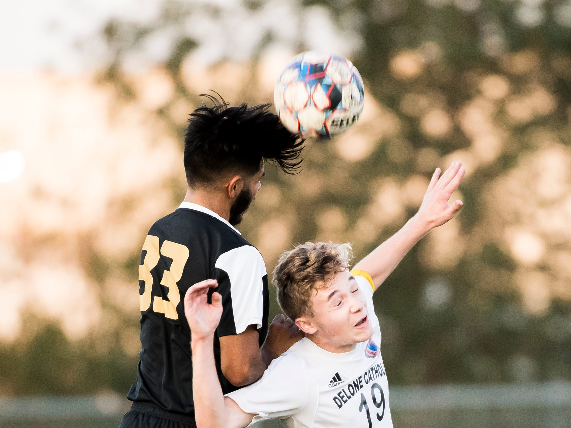 Biglerville's Jorge Acevedo hits a header over Delone Catholic's Noah Roeder on Wednesday, October 3, 2018. The Canners won 3-0.