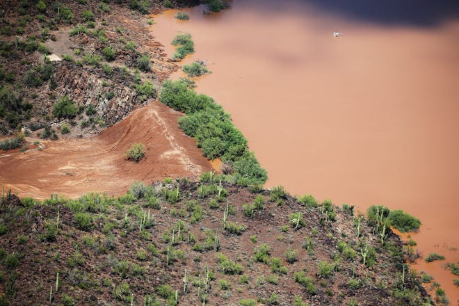 The earthen Menagers Dam is in imminent danger of failing, potentially sending floodwaters rushing into the Tohono O'odham village of Ali Chuk on Oct. 3, 2018, southwest of Sells, Ariz. Evacuations had begun Tuesday night after Hurricane Rosa's remnants drenched the western half of Arizona.