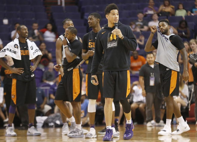 Suns guard Devin Booker introduces the rookie dance off during an open practice at Talking Stick Resort Arena on Saturday.