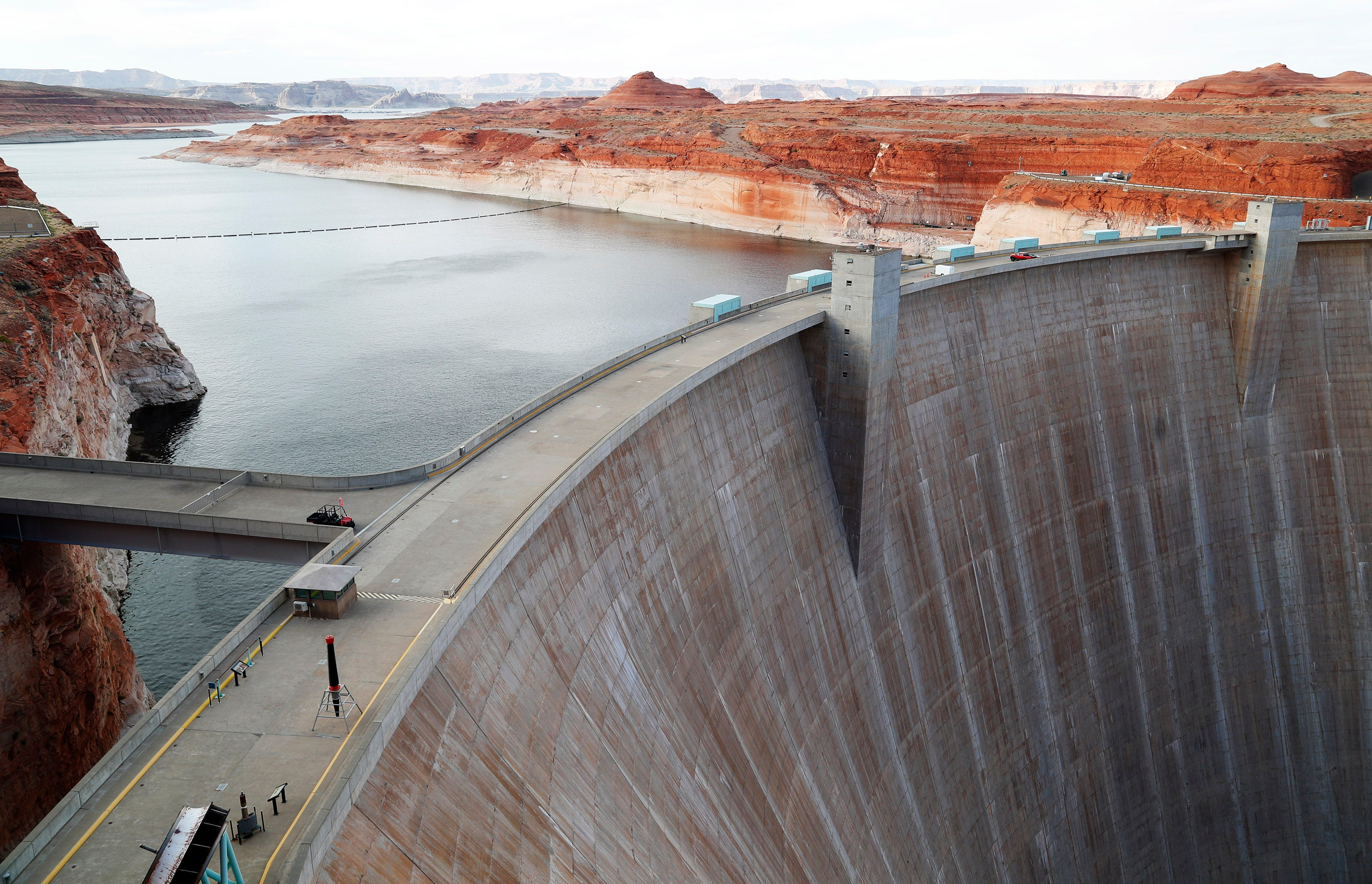 The Colorado River has suffered through mostly dry winters since the turn of the 21st century, offering less springtime snowmelt to refill Lake Powell than Glen Canyon Dam's engineers had counted on. The reservoir now sits about half empty, and the dam's hydropower water intake is closer to the warm surface. The turbines now churn and release warmer water than when the reservoir was full.