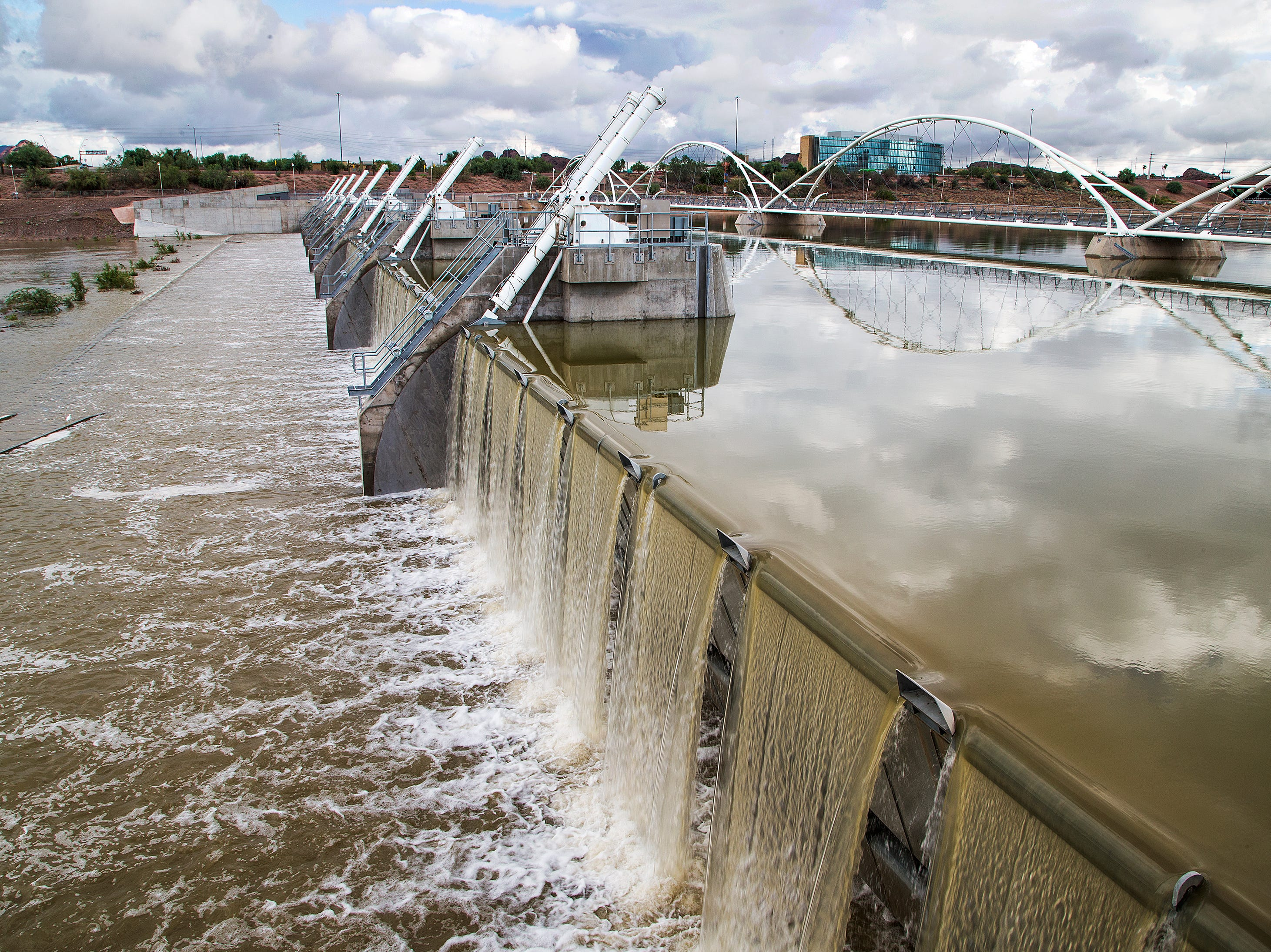 Due to recent record-breaking amounts of rain, water is released from Tempe Town Lake, Oct. 3, 2018.