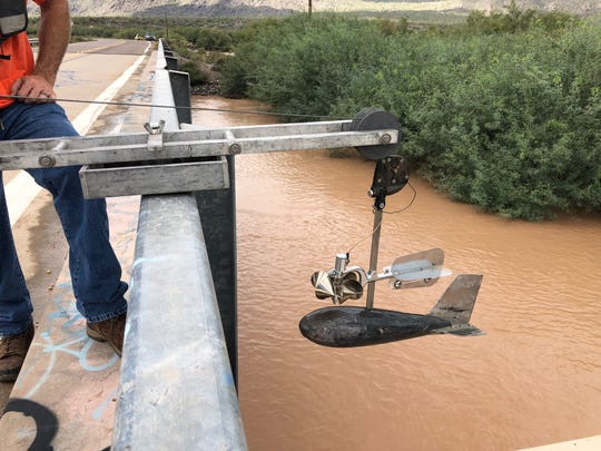 The Santa Cruz River is typically a dry river bed. On Wednesday, more than 7 feet of water flowed through it after rains from Rosa set records across the Valley.