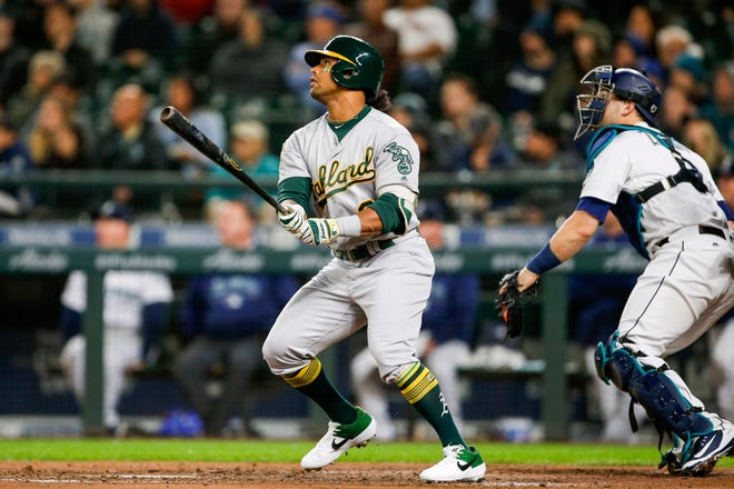 Oakland Athletics designated hitter Khris Davis (2) hits a solo home run against the Seattle Mariners during the sixth inning at Safeco Field this season. Davis finished with 48 home runs on the year.