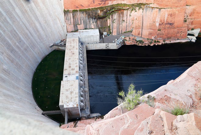 The Glen Canyon Dam is pictured below Lake Powell.