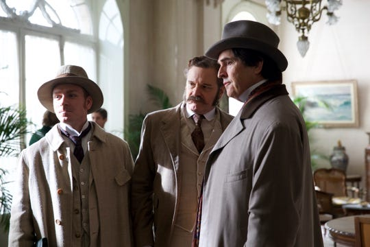 "(L-R) Edwin Thomas as Robbie Ross, Colin Firth as Reggie Turner, Rupert Everett as Oscar Wilde in ""The Happy Prince."""
