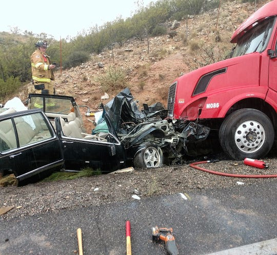 The driver of a 1993 Cadillac sedan received non-life-threatening injuries after colliding head-on with a semitruck on Tuesday.