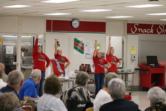 Oak Harbor High School cheerleaders perform cheers for senior citizens on Wednesday.