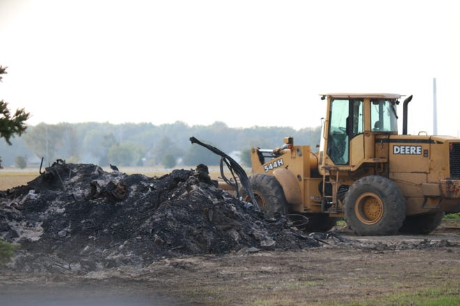 Heavy equipment cleared debris from the scene of a barn fire in Harris Township where a man was found dead on Sept. 11. The Ottawa County Sheriff's Office released new details about the fatality this week.