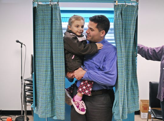 Marc Molinaro, candidate or the NYS 103rd Assembly District, exits the voting booth with his daughter, Abigail, after voting at Red Hook Town Hall on Tuesday, November 4, 2008.