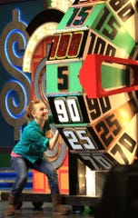 "A contestant competes on ""The Price is Right Live."" The interactive live version of the TV game show comes to the Riverside Theater Saturday for two shows."