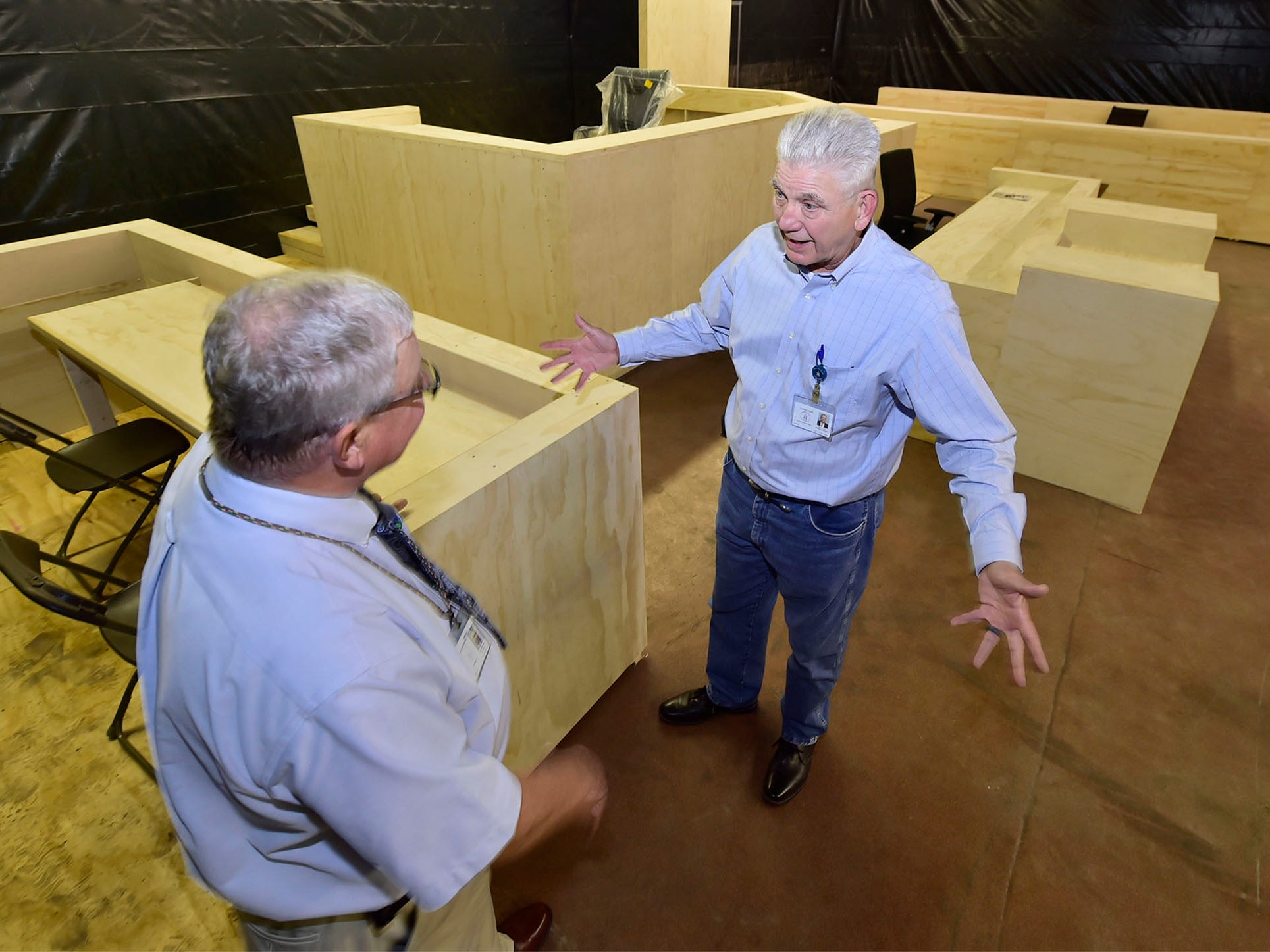 John Hart, project manager, talks to Terry Czap, left, a Franklin County court crier, at one of three life-size models of courtrooms on Wednesday, Oct. 3, 2018. The county set up the mock-ups in the old Jennings dealership on North Second Street between Grant and Broad streets, Chambersburg.