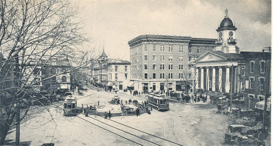 Trolleys drive past the Chambersburg Trust Building in Memorial Square in 1906.
