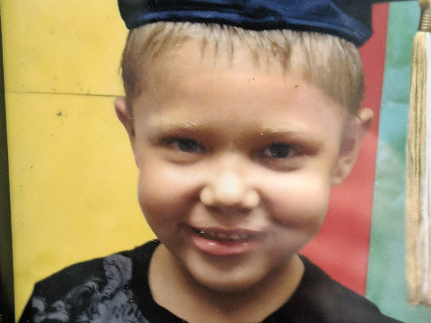 Ashton Potts in a kindergarten graduation photo.