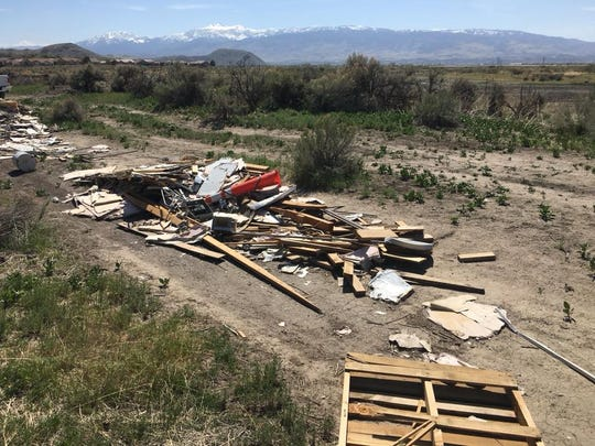 A large illegal dump of construction materials covers a path in Hidden Valley east of Reno in April, 2018. A Washoe sheriff's inmate work crew cleaned it up.