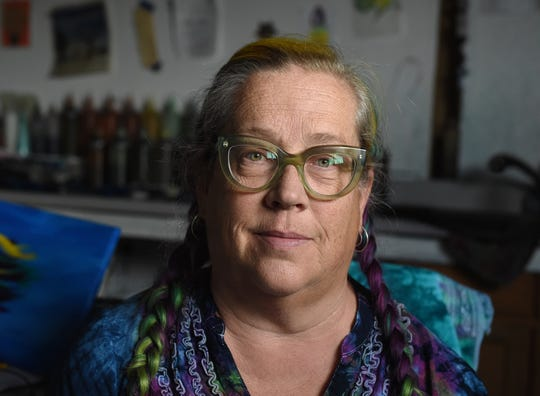 Artist Lauren Hufft sits in her Reno studio on Oct. 1, 2018.