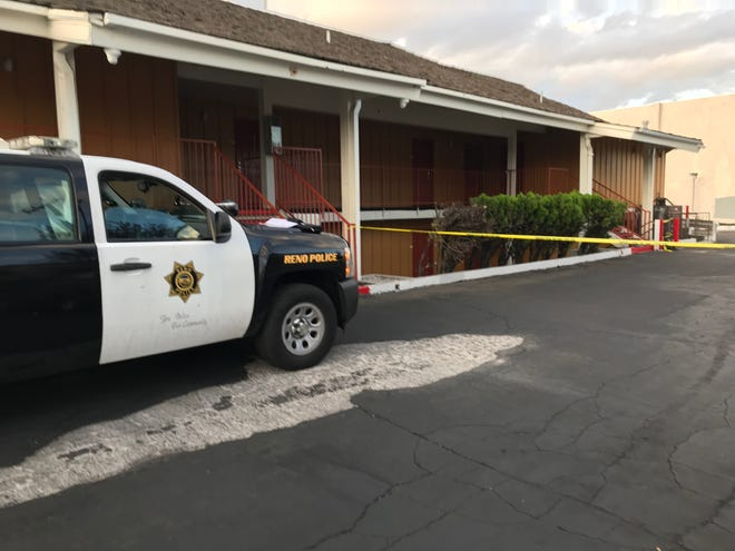 A Reno Police Department vehicle parked in front of a crime scene at the Econo Lodge near the corner of South Virginia Street and Plumb Lane where an early-morning shooting occurred on Oct. 3, 2018.