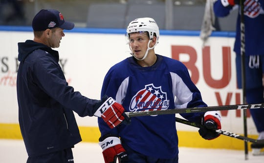 Chris Taylor, shown here with Kyle Crisculo, has led Rochester to 91- and 99-point seasons but has to win a playoff game. He's eager to keep growing as a head coach in the AHL rather than take an assistant's job in the NHL or a head position before he's ready.