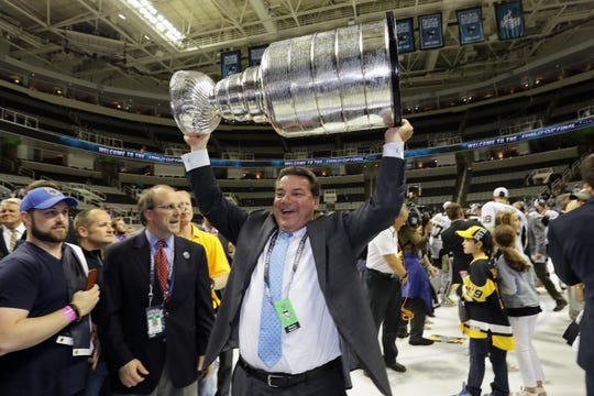 Amerks general manager Randy Sexton hoists the Stanley Cup as director of scouting for the Pittsburgh Penguins. He starts his second season of rebuilding a winning culture in Rochester, the Buffalo Sabres' farm team.