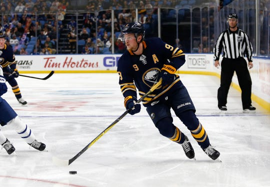 The Buffalo Sabres hockey franchise is suing  immigration officials, saying they wrongly denied an immigrationgreen card for a team trainer. Here, Sabres center Jack Eichel skates in a preseason game against the Toronto Maple Leafs in 2019.