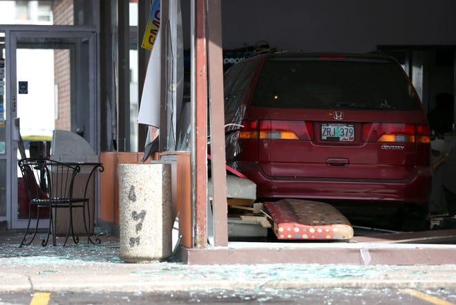 A minivan crashed into a Daynight Donuts on the corner of Fairgrounds Road NE and Woodrow Street NE on Wednesday, Oct. 3, 2018 in North Salem.
