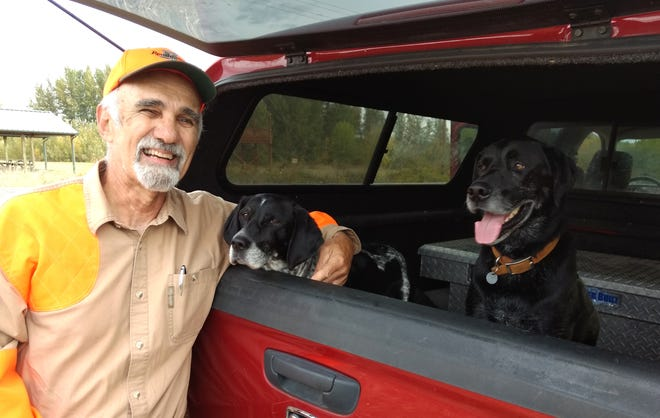 Bill Parks of Salem shares a break in the field with the aptly named Arrow and the queen of aerial pheasant-catching, Bow.