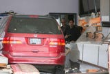 Surveillance cameras capture the moment a minivan crashes through the entrance of the Daynight Donuts shop Wednesday afternoon.